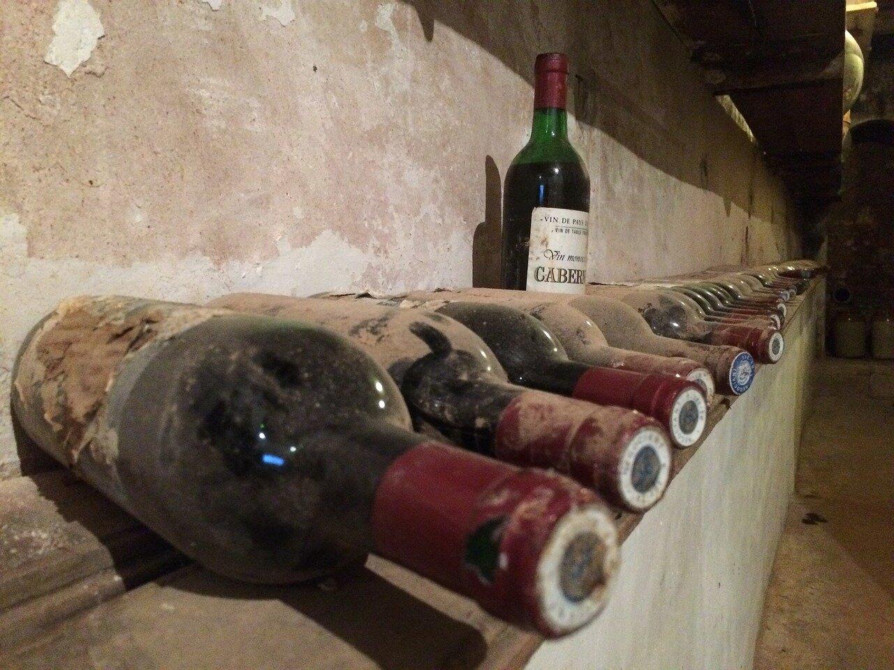 How long should I keep my fine wine bottles aging?